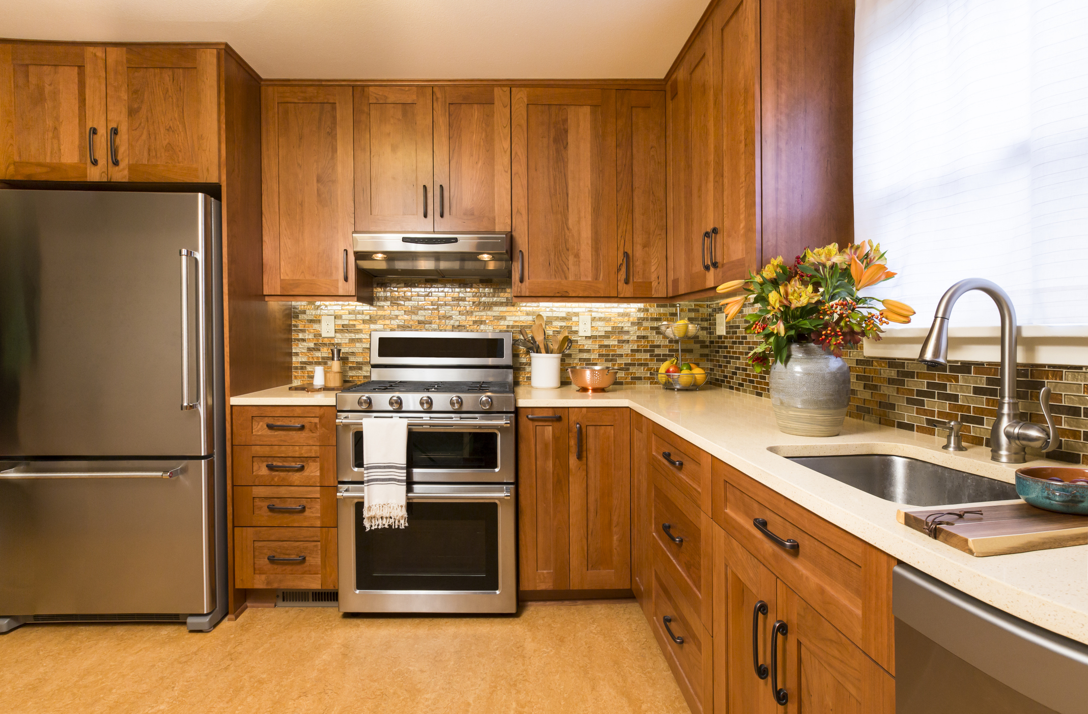 Contemporary upscale kitchen with wood cabinets and stainless steel appliances